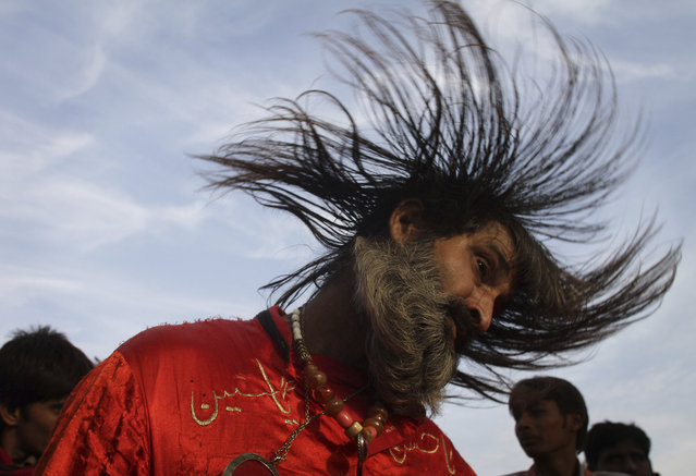A Pakistani Muslim devotee, or Malang, dances to celebrate the three-day annual congregation of famous saint Data Ganjbaksh at a shrine in Lahore, Pakistan, Thursday, December 11, 2014. Thousands of people traveled from all over Pakistan to attend the celebrations. (Photo by K. M. Chaudary/AP Photo)