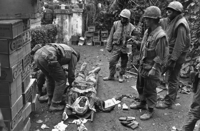 A wounded American soldier being attended to during the Vietnam war, 19th February 1968. (Photo by Terry Fincher/Daily Express/Hulton Archive/Getty Images)