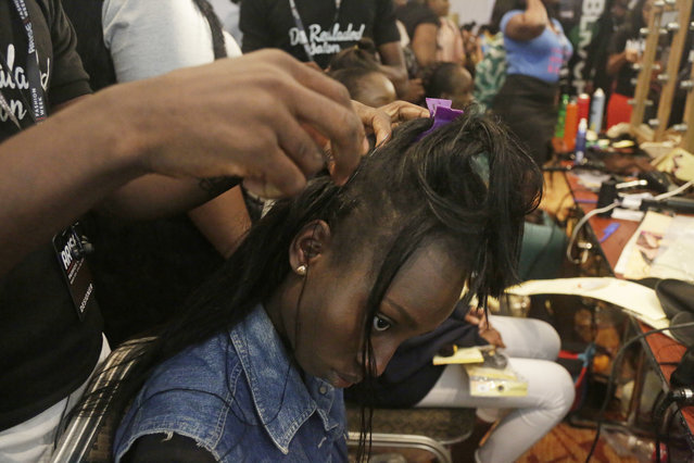 A model does her hair before the ARISE Fashion Week event in Lagos, Nigeria Saturday, March 31, 2018. (Photo by Sunday Alamba/AP Photo)