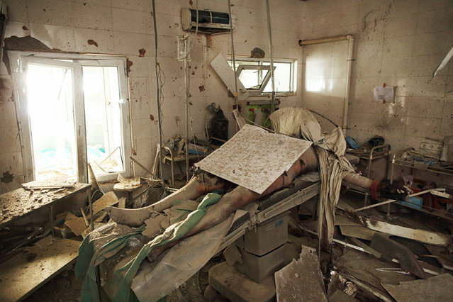 "A patient, later identified as 43-year-old husband and father of four, Baynazar Mohammad Nazar, lies dead on the operating table inside the Médecins Sans Frontières Kunduz Trauma Center in Afghanistan, following the 3 October attack by an American AC-130 gunship on the hospital in which 41 were killed. ""It's an image to stop you in your tracks"", the awards team said. ""Even before you know the background to the photograph, that single frame damns all the horror and devastation of war to destroy the innocent"". (Photo by Andrew Quilty/The Walkley Foundation)"