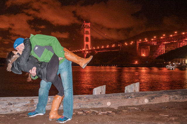 Husband and wife Rob 34 and Joli Switzer 33 from Maryland, do their DipKiss pose near the Golden Gate Bridge, San Francisco, Ca. (Photo by Dipkiss Travels/Caters News Agency)