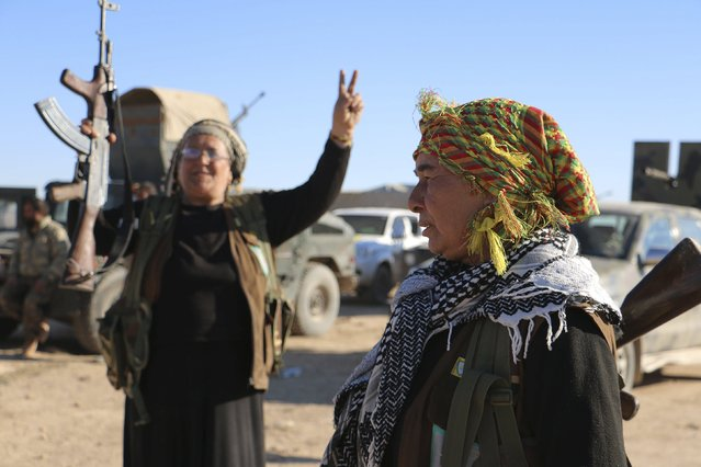 Kurdish guard women from the civilian protection unit which supports the Democratic Forces of Syria, cheer near the Syrian town of al Houl in Hasaka province, after the Democratic Forces of Syria took control of the area, November 14, 2015. (Photo by Rodi Said/Reuters)