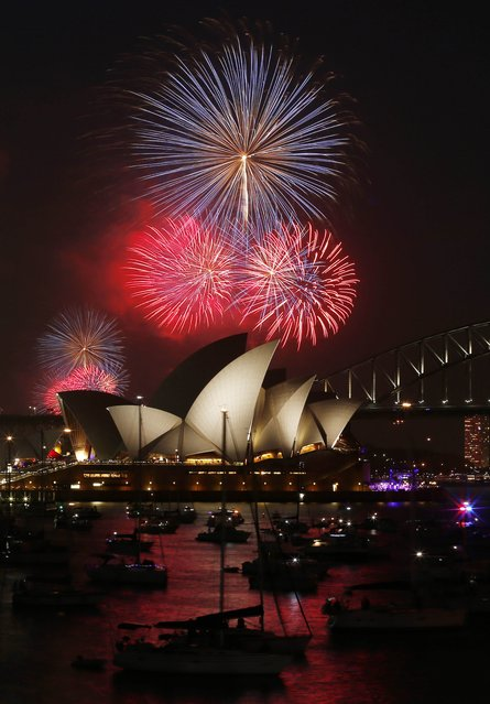 Fireworks light up the Sydney Opera House and Harbour Bridge during an early light show before the midnight New Year fireworks, December 31, 2014. (Photo by Jason Reed/Reuters)