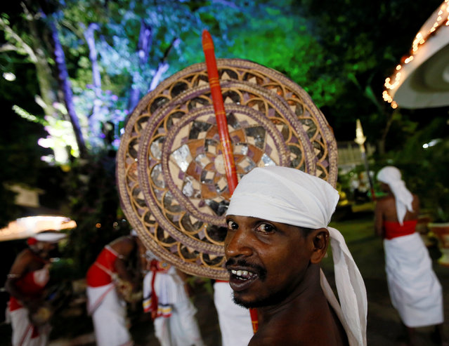 A traditional dancer looks on before the annual Sri Dalada Perahera (street parade) at a Buddhist temple in Colombo, Sri Lanka September 7, 2016. (Photo by Dinuka Liyanawatte/Reuters)
