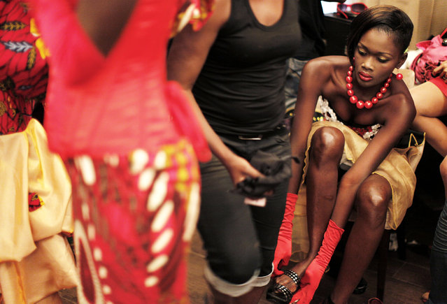 A model puts on a shoe backstage before a show during Dakar Fashion Week July 17, 2010. (Photo by Finbarr O'Reilly/Reuters)