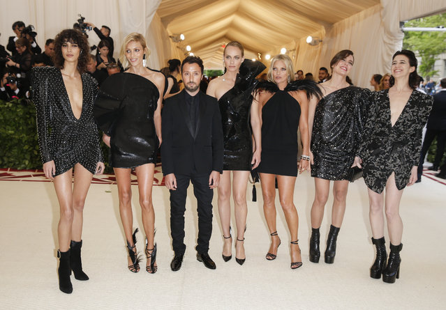 Mica Arganaraz, Anja Rubik, Anthony Vaccarrello, Amber Valletta, Kate Moss, Charlotte Casiraghi and Charlotte Gainsbourg attend The Metropolitan Museum of Art's Costume Institute benefit gala celebrating the opening of the Heavenly Bodies: Fashion and the Catholic Imagination exhibition on Monday, May 7, 2018, in New York. (Photo by Carlo Allegri/Reuters)
