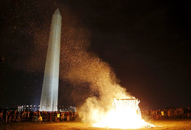 "An interactive art installation created by artist Michael Verdon called the ""Temple of Essence"" dedicated to ""victims of the war on drugs"" is burned on the U.S. National Mall in front of the Washington Monument in Washington November 22, 2015. (Photo by Jim Bourg/Reuters)"
