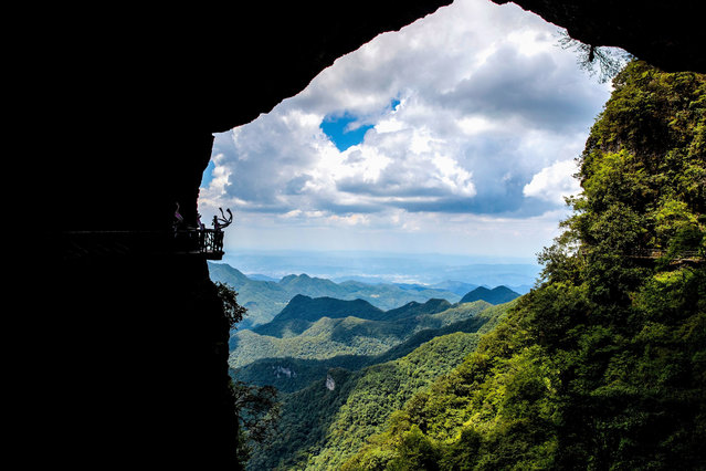 "A view from inside a cave at the Foshan world heritage site in Nanchuan, China on December 30, 2020. As a national 5A-level scenic spot, a national nature reserve, a national forest park, and a national base for science popularization and education, Jfoshan is a World Heritage site. Its beautiful natural scenery often makes people linger on and forget to return. Jfoshan is surrounded by the ""sea"" to reveal the top of the mountain. The constantly changing sea of clouds is like the waves of the sea, which attracts many tourists to see the ""sea"". (Photo by Sipa Asia/Rex Features/Shutterstock)"