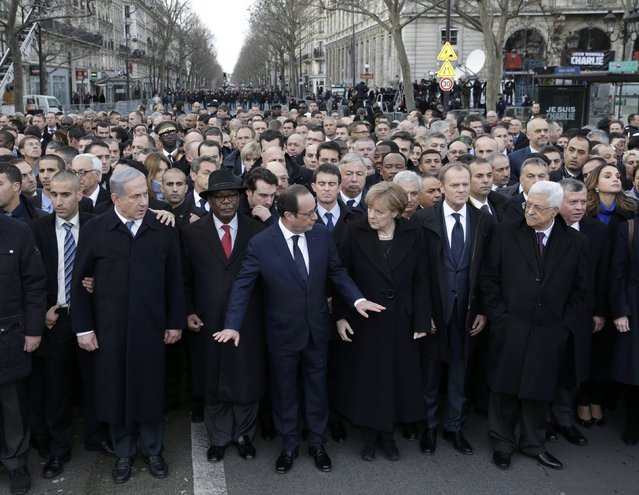 French President Francois Hollande is surrounded by heads of state as they attend the solidarity march (Marche Republicaine) in the streets of Paris January 11, 2015. (Photo by Philippe Wojazer/Reuters)