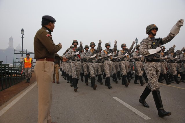Indian paramilitary soldiers march during rehearsals for the upcoming Republic Day parade in New Delhi, India, Thursday, January 14, 2015. U.S. President Barack Obama will be Chief Guest in this year's Republic Day parade, marked annually on Jan. 26. (Photo by Manish Swarup/AP Photo)