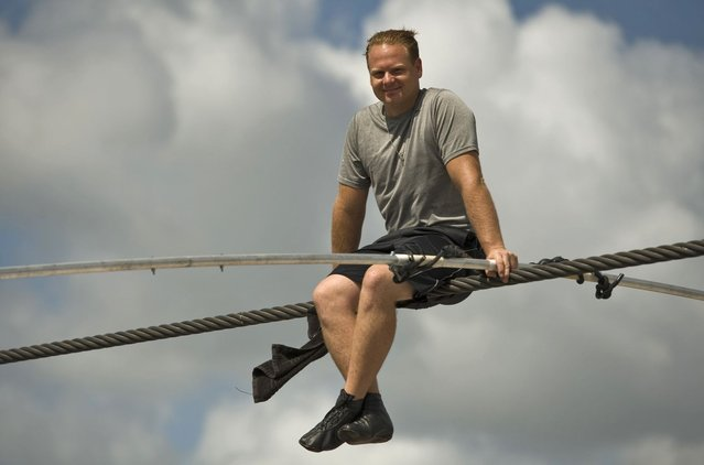 High wire walker Nik Wallenda balances on a 1,200 foot (366 meter) cable during a practice session in Sarasota, Florida, June 14, 2013. Wallenda is training for his untethered high wire walk across the Grand Canyon scheduled for June 23. (Photo by Steve Nesius/Reuters)