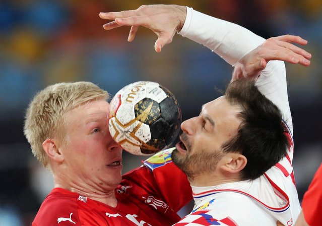 Denmark's Morten Toft Olsen in action with Croatia's Igor Karacic during the IHF Handball World Championships in Cairo, Egypt on January 25, 2021. (Photo by Mohamed Abd El Ghany/Reuters)