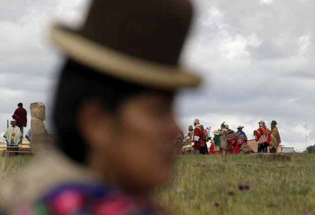 An Aymara indigenous woman attends an Andean ceremony with Bolivia's President Evo Morales (not pictured) in Tiahuanaco some 70 km from La Paz, January 21, 2015. (Photo by David Mercado/Reuters)