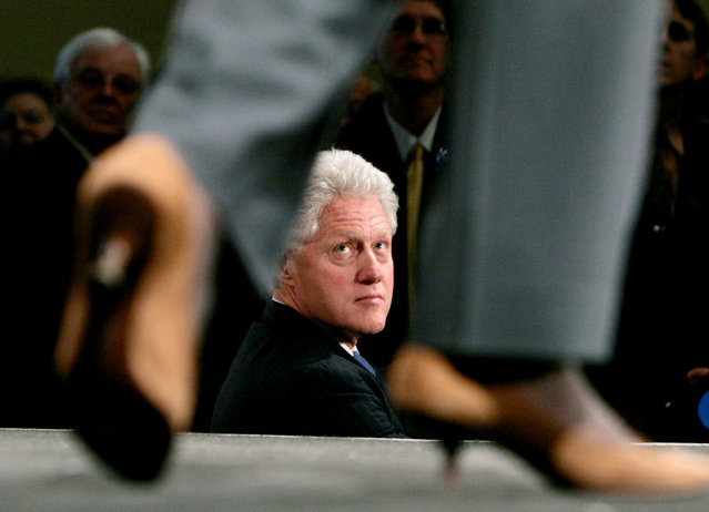 Former U.S. President Bill Clinton listens to his wife, U.S. Senator and Democratic presidential candidate Hillary Rodham Clinton (D-NY), speak at a campaign fund-raiser in Washington March 20, 2007. (Photo by Jim Young/Reuters)