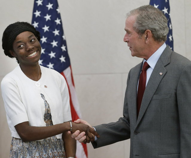 Former President George W. Bush, right, shakes hands with with Mondell Bernadette Avril after she was sworn in as a U.S. citizen during a ceremony at the The George W. Bush Presidential Center in Dallas, Wednesday, July 10, 2013. Twenty new citizens took the oath of U.S. citizenship at the former president's library. (Photo by L. M. Otero/AP Photo)