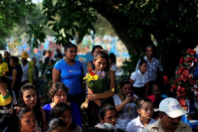 Members of Comandos de Salvamento and relatives of the deceased participate in the funeral of 14-year-old volunteer Erick Beltran, who was killed by suspected gang members, in Quezaltepeque, El Salvador April 13, 2016. (Photo by Jose Cabezas/Reuters)