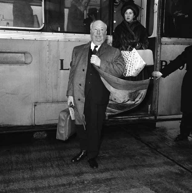 Alfred Hitchcock, Hollywood's Whodunit King, spends two hours at London Airport, United Kingdom, on January 6, 1963, during a stopover on a flight to New York. Hitchcock is returning to America from Zurich. During the stopover he took the opportunity to confer with a London-based business associate. (Photo by AP Photo/Boy)