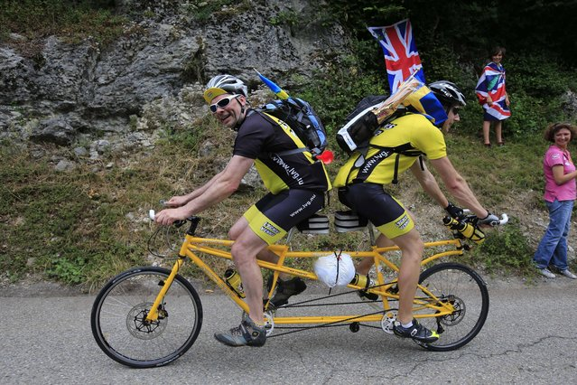 Sweden's Ake Johansson, left, and a friend climb L'Epine pass on a self-made tandem bicycle during the nineteenth stage of the Tour de France cycling race over 204.5 kilometers (127.8 miles) with start in in Bourg-d'Oisans and finish in Le Grand-Bornand, France, Friday July 19 2013. (Photo by Peter Dejong/AP Photo)