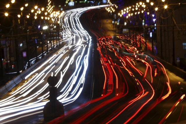 Vehicles drive along a road in Moscow, Russia, February 3, 2016. Picture taken with long exposure. (Photo by Maxim Shemetov/Reuters)