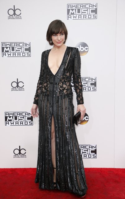 Actress Milla Jovovich arrives at the 2016 American Music Awards in Los Angeles, California, U.S., November 20, 2016. (Photo by Danny Moloshok/Reuters)