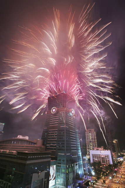 A fireworks display is set off from the Taipei 101 skyscraper during the New Year's Eve celebrations in Taipei, Taiwan, Friday, January 1, 2016. (Photo by Wally Santana/AP Photo)