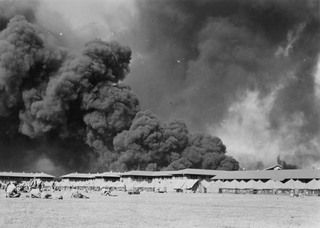 U.S. Marines await the possible return of Japanese aircraft on the parade ground at the Pearl Harbor Marine Barracks,  Hawaii, U.S. December 7, 1941. (Photo by Reuters/U.S. Naval History and Heritage Command)
