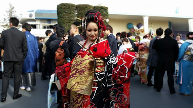 A twenty year old female dressed in Kimono attend Coming-of-Age Day ceremony at Tokyo Disney Land ,11 January 2016. (Photo by Satoko Kawasaki)