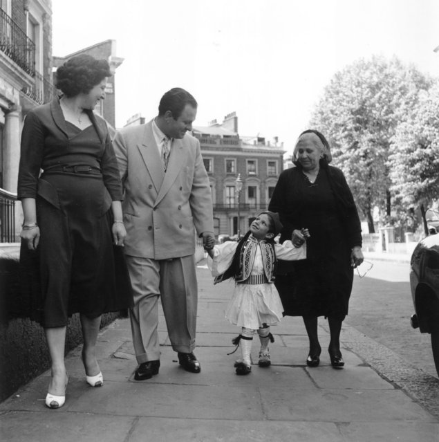Three generations of the Constantinous, a Greek Cypriot family who live in Bayswater, London, 16th June 1956. The child is wearing the uniform of the Evzones, a Greek army regiment. (Photo by Bert Hardy/Picture Post/Getty Images)