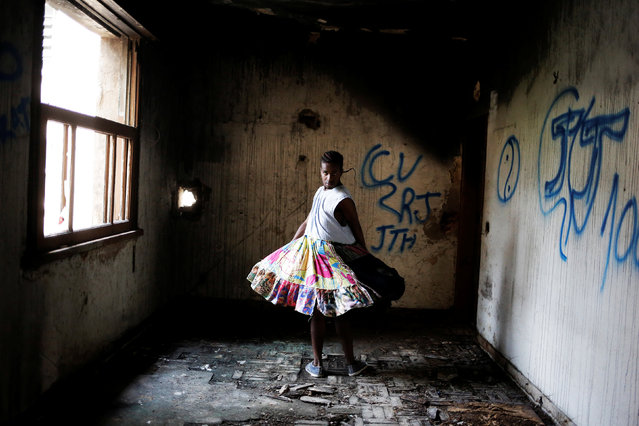 Vitor, 21, who is among members of lesbian, gay, bisexual and transgender (LGBT) community, that have been invited to live in a building that the roofless movement has occupied, poses for a portrait, in downtown Sao Paulo, Brazil, November 26, 2016. (Photo by Nacho Doce/Reuters)