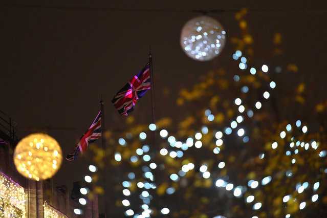 British flags are seen between illuminated Christmas lights on Oxford Street in London, Britain December 9, 2016. (Photo by Clodagh Kilcoyne/Reuters)