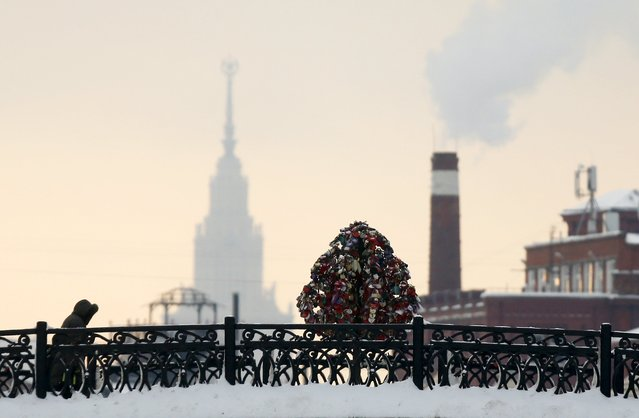 A pedestrian walks along a bridge in central Moscow, Russia, January 25, 2016. (Photo by Maxim Shemetov/Reuters)