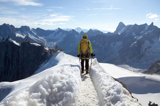 """Alpine mountaineers at Mont Blanc. Mont Blanc, meaning """"White Mountain"""", is the highest mountain in the Alps and the highest in Europe west of Russia's Caucasus peaks. (Photo by mikeuk/Getty Images)"""