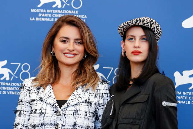 """Spanish actress Penelope Cruz (L) and Spanish actress Milena Smit pose during a photocall for the film """"Madres Paralelas"""" (Parallel Mothers) on the opening day of the 78th Venice Film Festival, on September 1, 2021 at Venice Lido. (Photo by Yara Nardi/Reuters)"""