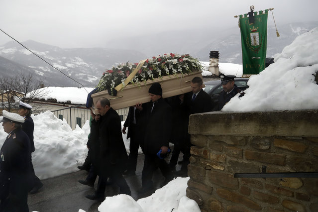 The coffin of Alessandro Giancaterino, one of the victims of the avalanche which buried the Hotel Rigopiano, is shoulder carried prior to the start of the funeral service in Farindola, central Italy,Tuesday, January 25, 2017. The death toll from an avalanche in central Italy climbed to 14 on Tuesday as hopes began to fade that any of the 15 people still missing might be found alive under a mountain resort buried by tons of snow and rubble. (Photo by Gregorio Borgia/AP Photo)