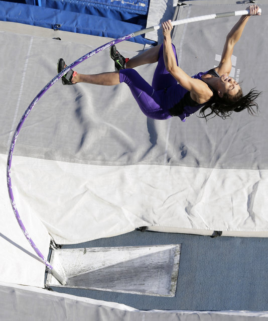 Stephen F. Austin's pole vaulter Demi Payne competes in the Drake Relays Street Vault, Wednesday, April 22, 2015, in downtown Des Moines, Iowa. (Photo by Charlie Neibergall/AP Photo)