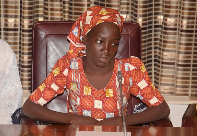 In this Thursday, May 19, 2016 file photo, Amina Ali, the rescue Chibok school girl, sits during a meeting with Nigeria's President Muhammadu Buhari at the Presidential palace in Abuja, Nigeria. Nigeria's Bring Back Our Girls movement demanded Wednesday, June. 22, 2016 that the government provide news of the only one of 219 kidnapped schoolgirls to escape the clutches of the Boko Haram extremist group. (Photo by Azeez Akunleyan/AP Photo)