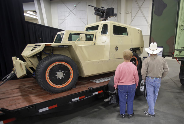 Robert and Dori Wickert look at a prototype combat vehicle during the PrepperCon expo Friday, April 24, 2015, in Sandy, Utah. (Photo by Rick Bowmer/AP Photo)