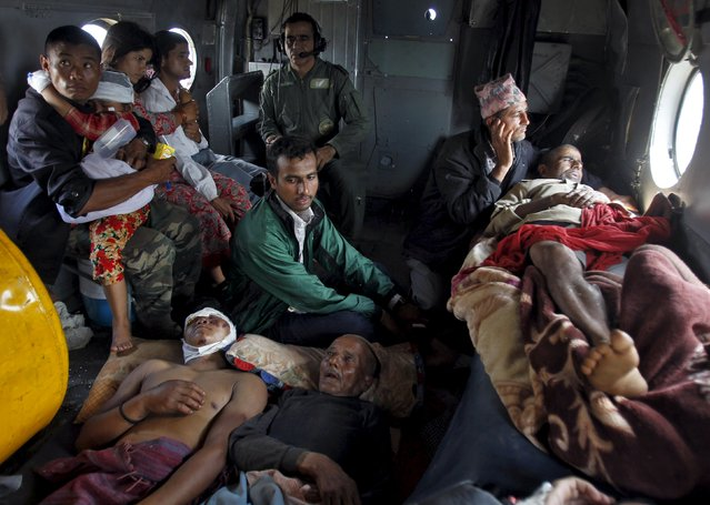 Victims of Saturday's earthquake rest inside an Indian Air Force helicopter as they are evacuated from Trishuli Bazar to the airport in Kathmandu, Nepal, April 27, 2015. (Photo by Jitendra Prakash/Reuters)