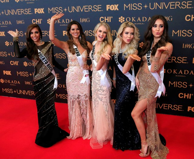 Miss Universe candidates gestures for a picture during a red carpet inside a SMX convention in metro Manila, Philippines January 29, 2017. In Photo from L-R: Miss Russia Puerto Rico Brenda Jimenez, Miss Peru Valeria Piazza, Miss Norway Christina Waage, Miss Sweden Ida Ovmar and Miss Poland Izabella Krzan. (Photo by Romeo Ranoco/Reuters)