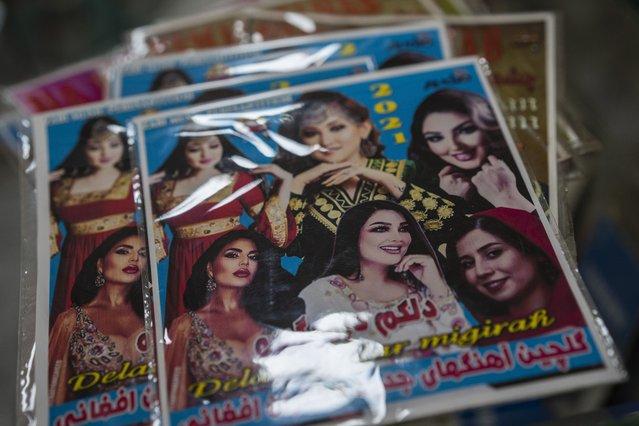 DVDs of Afghan singers sit in a shop in Kabul, Afghanistan, Saturday, September 18, 2021. (Photo by Bernat Armangue/AP Photo)