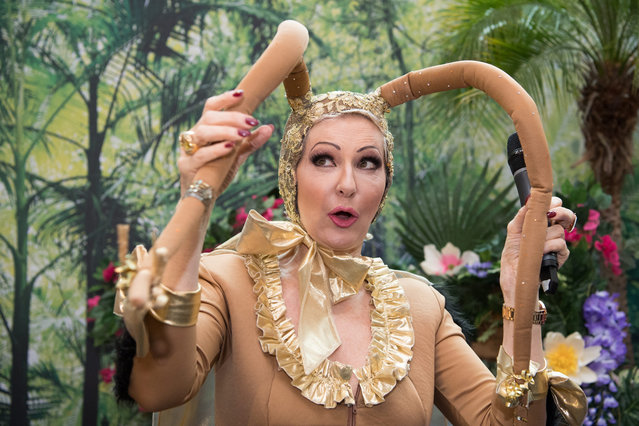 German television entertainer Desiree Nick dressed as a cockroach presents a game during media day at the Spielwarenmesse (toy fair) in Nuremberg, Germany, on 31 January 2017. Over 70,000 visitors and more than 2,800 exhibitors from over 60 countries are expected to attend the international toy fair from 01 February until 06 February 2017. (Photo by Sebastian Widmann/EPA)