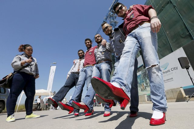 "Men wearing high-heeled shoes pose for a picture during a march to protest against sexual violence against women in a fundraising event called ""Walk A Mile In Her Shoes"" in Beirut April 26, 2015. (Photo by Mohamed Azakir/Reuters)"
