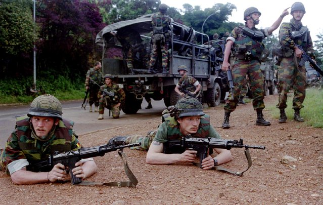 Belgian troops prepare to inspect the city of Kigali on the sixth day of violence, April 11, 1994. (Photo by Reuters/Stringer)