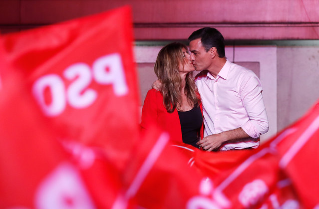 Spain's Prime Minister Pedro Sanchez of the Socialist Workers' Party (PSOE) kisses his wife Begona Gomez while celebrating the result in Spain's general election in Madrid, Spain, April 29, 2019. (Photo by Sergio Perez/Reuters)