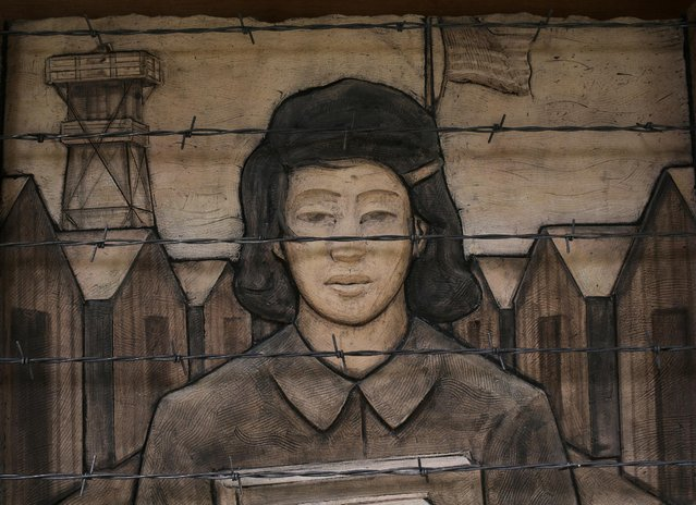 A terra cotta frieze, by artist Steve Gardner, depicts an imprisoned schoolgirl at the Japanese American Exclusion Memorial on Puget Sound's Bainbridge Island, Washington, U.S. February 12, 2017. The island's Japanese-American community was the first to be sent to World War Two internment camps after President Theodore Roosevelt signed executive order 9066 75 years ago, on February 19, 1942. (Photo by Chris Helgren/Reuters)