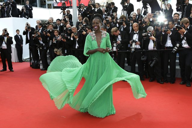 Lupita Nyong'o arrives for the opening ceremony and the screening of the film La Tete Haute (Standing Tall) at the 68th international film festival, Cannes, southern France, Wednesday, May 13, 2015. (Photo by Joel Ryan/Invision/AP Photo)