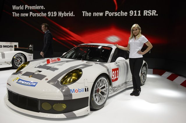The new Porsche 911 RSR  is on display during the press day at the 84.  Geneva International Motor Show in Geneva, Switzerland, Tuesday, March 4, 2014.  (Photo by Martial Trezzini/AP Photo/Keystone)