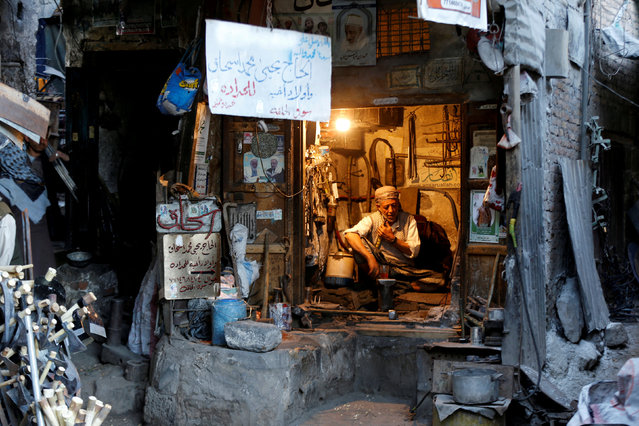 A blacksmith sits in his shop at the Souq al-Melh market in the old quarter of Sanaa, Yemen, January 9, 2019. (Photo by Khaled Abdullah/Reuters)
