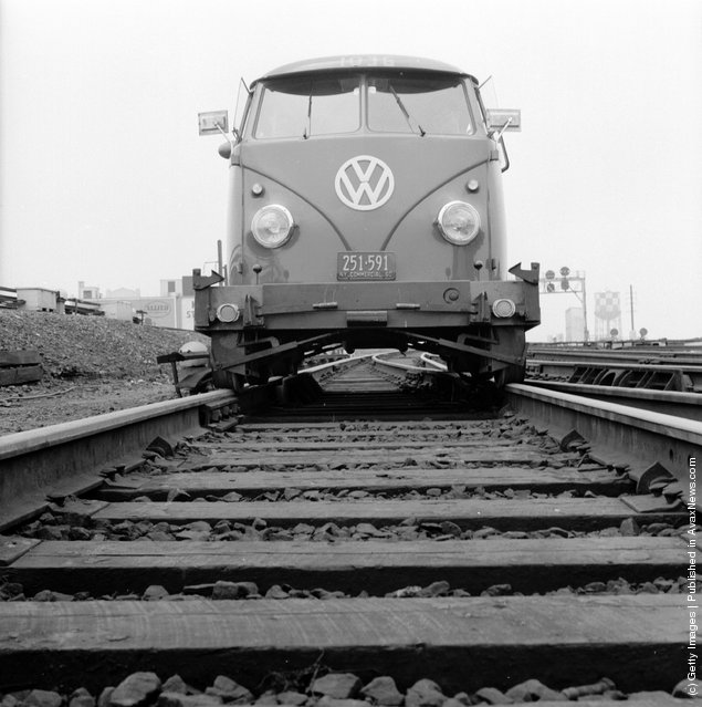 1956: Volkswagen travelling along the tracks of the Long Island railroad
