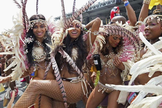 """Revellers of Fantasy Carnival's """"Secrets of the Deep"""" presentation dance onstage during the annual Carnival festival, at the Queen's Park Savannah in Port-of-Spain, on March 5, 2014. (Photo by Andrea De Silva/Reuters)"""